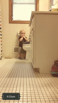And, back to the bathroom. This time he found his FAVORITE toy, the plunger.