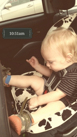 Shoes always end up undone while he rides in the car. It's odd.