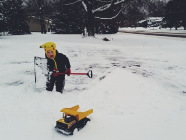 Again...the truck. He digs roads for it to drive on. I help.