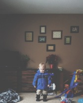 His first, real, time getting all bundled up to play--we still had a few items of clothing left to go.