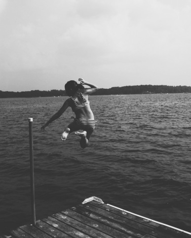 Jumping into the lake on a warm, summer, day.